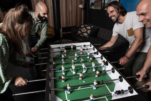 Table football with team at the office - Mooring Yachts